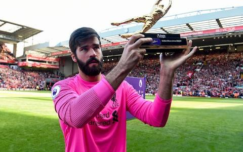 Alisson Becker of Liverpool with the golden glove at the end of the Premier League match between Liverpool FC and Wolverhampton Wanderers - Credit: GETTY IMAGES