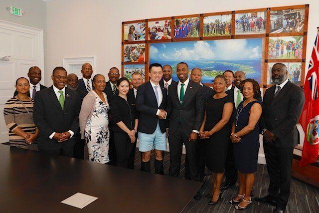 Binance CEO Changpeng Zhao shakes hands with Bermuda Premier David Burt at a press conference on the island on April 27, 2018, to announce Binance's investment in a Bermuda office. (Government of Bermuda)