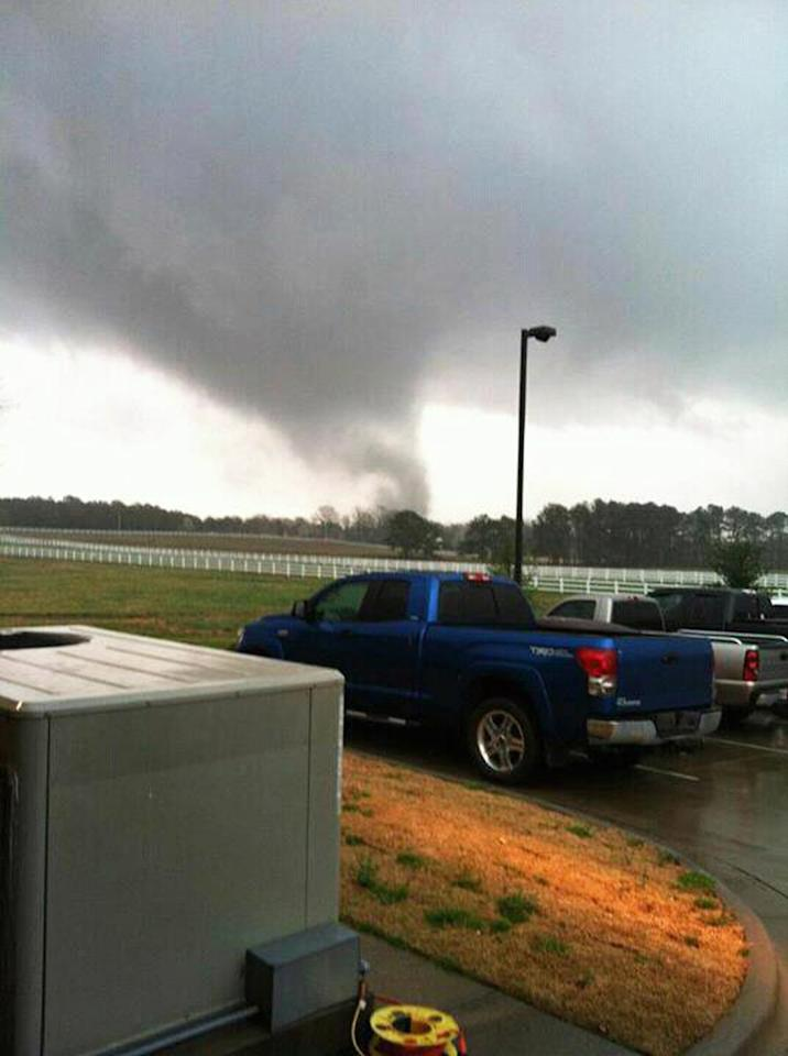 A funnel cloud begins to form over the Canebrake Subdivision of Athens, Ala., Friday, March 2, 2012. Homes were damaged and utilities were interrupted when several suspected tornadoes struck Limestone County Friday morning. (AP Photo/Chris Simmons, Athens Fire and Rescue Dept.)