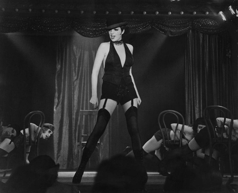 """<p>Evoke Berlin in the 1930s via New York in the 1970s with Liza Minnelli's famous """"Mein Herr"""" ensemble. An LBD (or vest and hotpants), garters, derby cap, and a beauty mark, divine decadence indeed. </p>"""