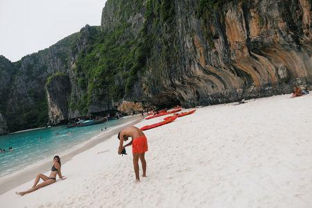 Tourists take photo as they visit Maya bay in Krabi province, Thailand May 22, 2018. REUTERS/Soe Zeya Tun