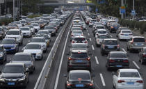 A busy highway is seen in Beijing on Tuesday, July 21, 2020. China's auto sales rose by 16.4% in July over a year earlier to 2.1 million units in a sign of sustained recovery for the industry's biggest global market, an industry group said Tuesday. (AP Photo/Ng Han Guan)