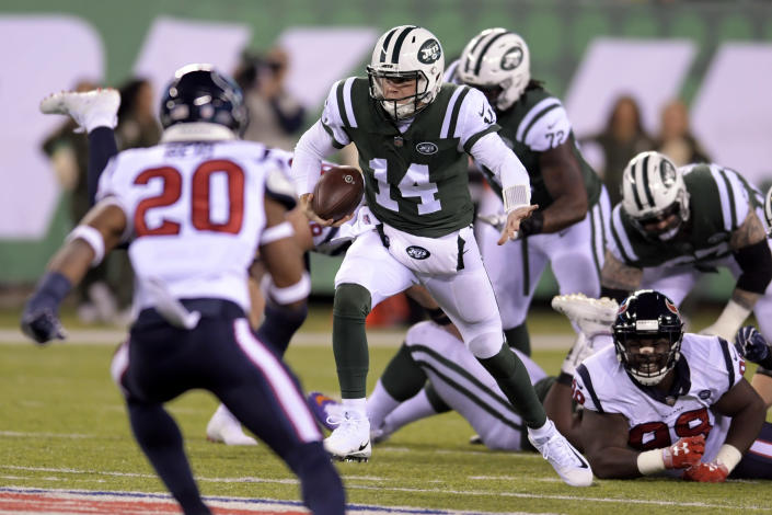 New York Jets quarterback Sam Darnold (14) scrambles as Houston Texans strong safety Justin Reid (20) tries to stop him during the first half of an NFL football game, Saturday, Dec. 15, 2018, in East Rutherford, N.J. (AP Photo/Bill Kostroun)