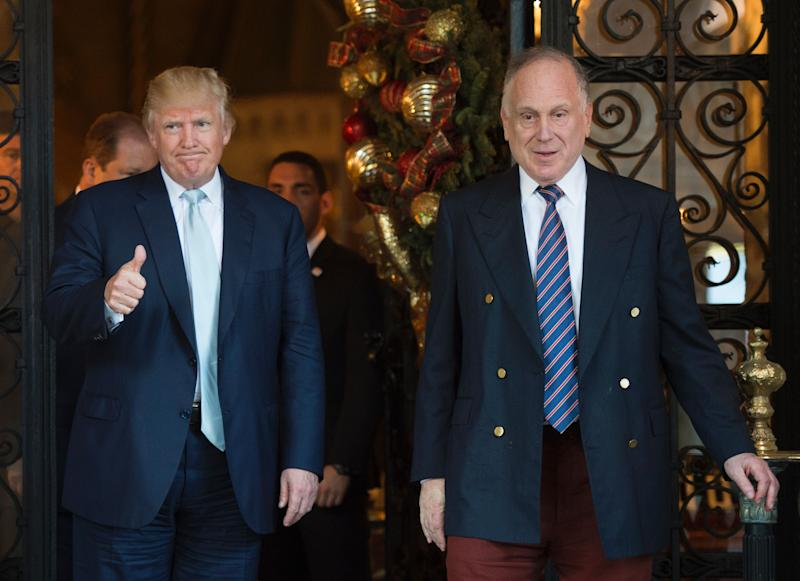 US President-elect Donald Trump gestures next to Ronald Lauder, President of the World Jewish Congress, after a meeting on December 28, 2016 at Mar-a-Lago in Palm Beach, Florida. / AFP / DON EMMERT (Photo credit should read DON EMMERT/AFP/Getty Images)