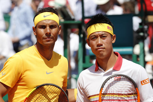 Spain's Rafael Nadal, left, and Japan's Kei Nishikori pose for photographers ahead of the men's singles final match of the Monte Carlo Tennis Masters tournament in Monaco, Sunday April 22, 2018. (AP Photo/Christophe Ena)