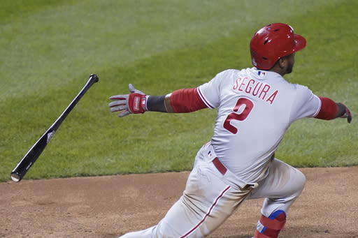 Philadelphia Phillies' Jean Segura drops the bat after hitting a single off New York Mets relief pitcher Jared Hughes during the eighth inning of a baseball game, Friday, Sept. 4, 2020, in New York. (AP Photo/John Minchillo)