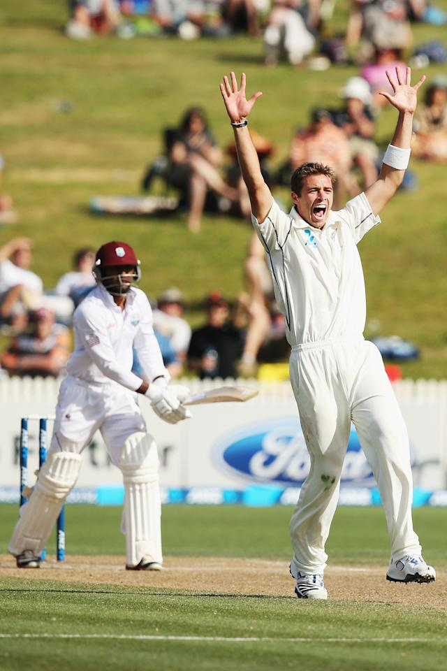 HAMILTON, NEW ZEALAND - DECEMBER 21:  Tim Southee of New Zealand celebrates claiming the wicket of Veerasammy Permaul of the West Indies during day three of the Third Test match between New Zealand and the West Indies at Seddon Park on December 21, 2013 in Hamilton, New Zealand.  (Photo by Hannah Johnston/Getty Images)