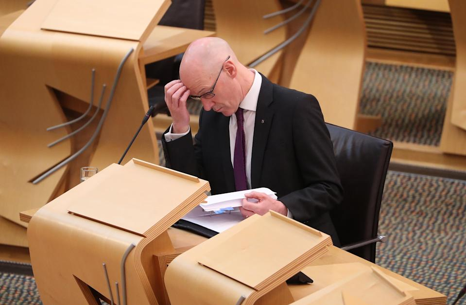 John Swinney wants to find a 'practical way' for MSPs to get access to the information (Andrew Milligan/PA)