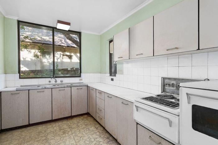 The apartment's kitchen appeared spotless in the real estate agent's original listing. The two-bedroom Wollstonecraft apartment in Sydney's lower north shore was put on the market last month, with an asking price of $775,000. Source: Di Jones