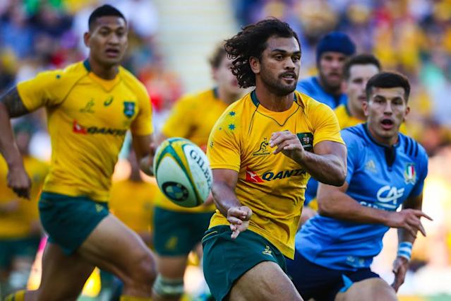 Wallabies and Queensland Reds star Karmichael Hunt (C) stood down voluntarily from all contractual obligations in December after he was detained in Brisbane (AFP Photo/Patrick HAMILTON)