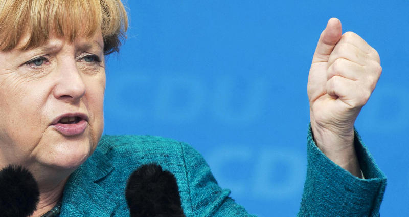 FILE - This is a Sunday, Sept. 15, 2013 file†photo of German Chancellor Angela Merkel as she gestures during an election campaign event of the German Christian Democratic Union (CDU) in Bad Koestritz, central Germany. It's been called the Merkel mystery: How did a pastor's daughter who once marched in the uniform of East Germany's communist youth end up leading a conservative, male-dominated party from West Germany to become the country's first female chancellor? (AP Photo/Jens Meyer, File)