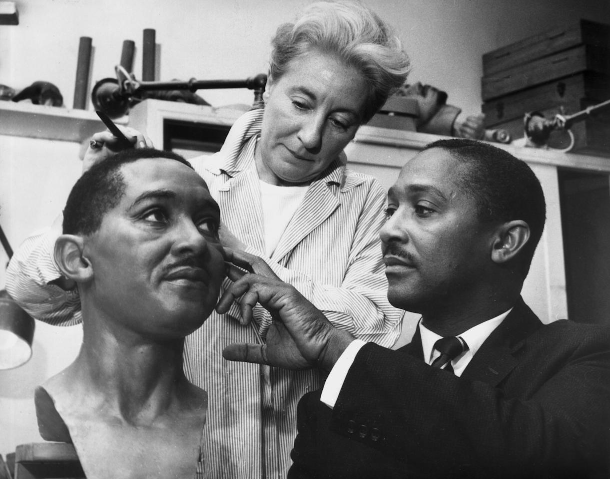 21st August 1963:  Frank Worrell (1924 - 1967), captain of the West Indies cricket team pictured overseeing the final touches to his Madame Tussaud's waxwork figure.  (Photo by Ron Case/Keystone/Getty Images)