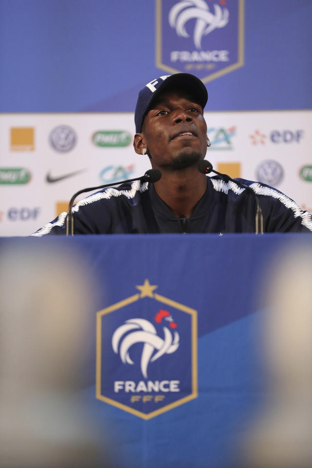 France's Paul Pogba answers journalists during a press conference at the 2018 soccer World Cup in Istra, Russia, Sunday, June 24, 2018. (AP Photo/David Vincent)