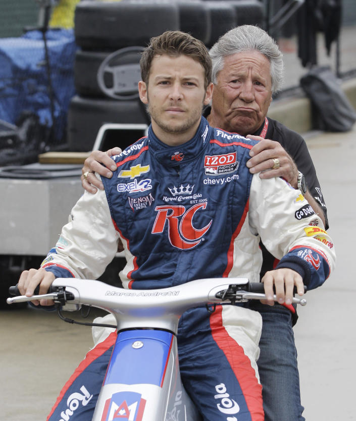 FILE - Mario Andretti rides with his grandson, driver Marco Andretti, to the pits before practice for the IndyCar auto race on Belle Isle in Detroit, in this Friday, June 1, 2012, file photo. Marco Andretti made the decision at the start of this year to step away from full-time racing and essentially end three generations of the most famous family in motorsports competing at the highest level. (AP Photo/Carlos Osorio, File)
