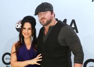 Lee Brice and his wife Sara pose on arrival at the 47th Country Music Association Awards in Nashville, Tennessee November 6, 2013. REUTERS/Eric Henderson (UNITED STATES - Tags: ENTERTAINMENT)