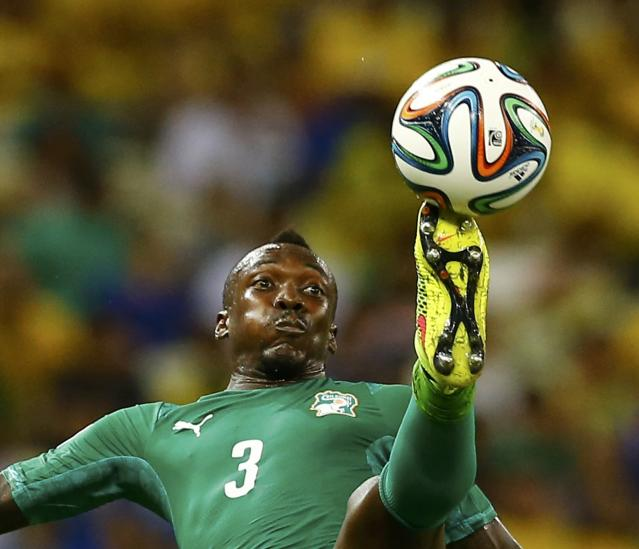 Ivory Coast's Arthur Boka kicks the ball during their 2014 World Cup Group C soccer match against Greece at the Castelao arena in Fortaleza June 24, 2014. REUTERS/Marcelo Del Pozo (BRAZIL - Tags: SOCCER SPORT WORLD CUP) TOPCUP