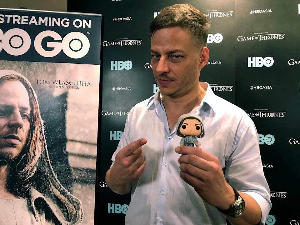 Tom Wlaschiha with a toy model of his character Jaqen H'ghar from HBO's Game of Thrones in Singapore on 1 December, 2017. Photo: Bryan Huang/Yahoo Lifestyle Singapore