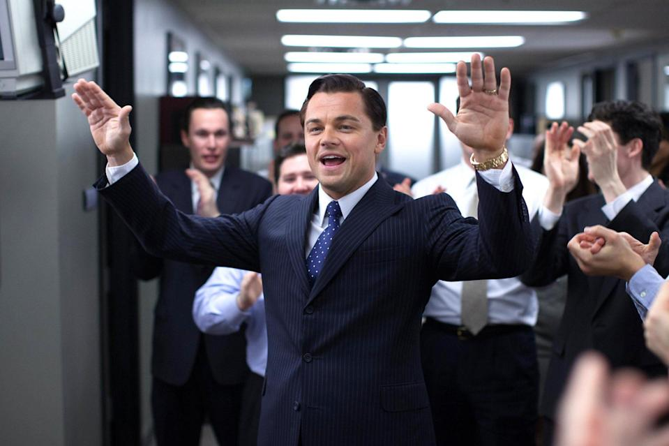 """<p>Excuse my language, but when talking about <em>The Wolf of Wall Street</em>, once the record-holder for expletives in a film, Leo can only be described a f---ing powerhouse in his portrayal of the sex and drug-fueled stockbroker Jordan Belfort. And while he's not usually known for making us laugh, Jordan and Donny's (Jonah Hill) lengthy quaalude trip is physical comedy at its finest. It's an iconic performance, further solidifying that he's <span>""""not f---ing leaving""""</span> his spot as our greatest movie star.</p> <p><b>Related: </b><a href=""""https://ew.com/article/2014/01/12/leonardo-dicaprio-golden-globes-backstage/"""" rel=""""nofollow noopener"""" target=""""_blank"""" data-ylk=""""slk:Leonardo DiCaprio at Globes: 'Thank God' I didn't become Jordan Belfort"""" class=""""link rapid-noclick-resp"""">Leonardo DiCaprio at Globes: 'Thank God' I didn't become Jordan Belfort</a></p>"""