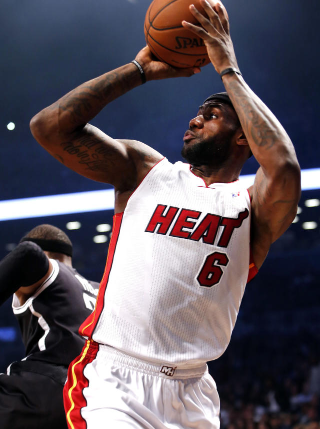 Miami Heat's LeBron James shoots against the Brooklyn Nets during an NBA basketball game Friday, Nov. 1, 2013, in New York. (AP Photo/Jason DeCrow)