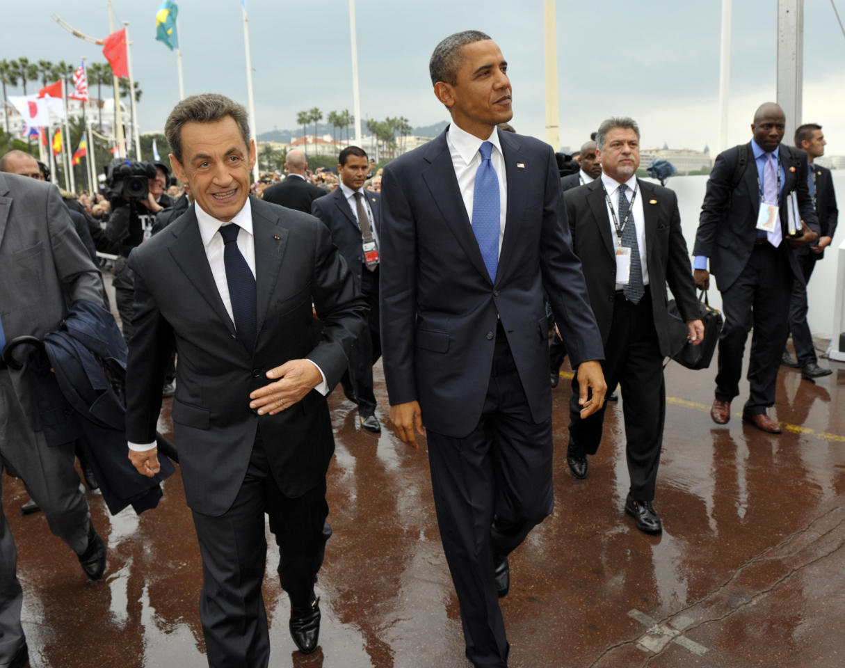 French President Nicolas Sarkozy, left, and US President Barack Obama walk together during arrivals for the G20 summit in Cannes, France on Thursday, Nov. 3, 2011. French President Nicolas Sarkozy will welcome Barack Obama of the U.S., Hu Jintao of China as well as the leaders of India, Brazil, Russia and the other members of the Group of 20 leading world economies in the city made famous by its annual film festival, but the event is far from the star turn the unpopular French leader had hoped to make six months before he faces a tough re-election vote. (AP Photo/Philippe Wojazer, Pool)