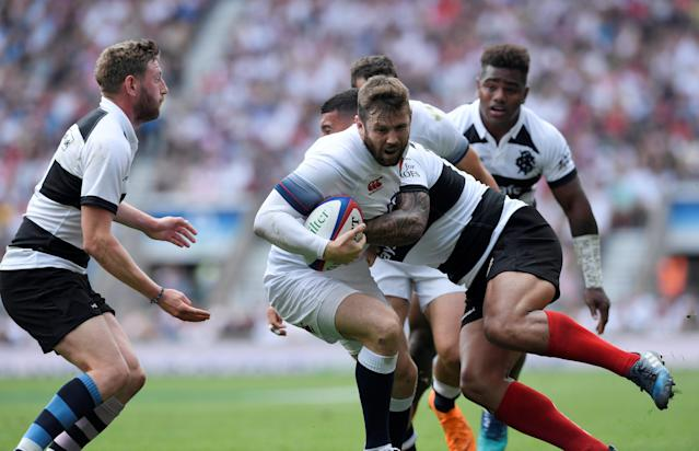Rugby Union - England v Barbarians, Twickenham Stadium, London, Britain - May 27, 2018 England's Elliott Daly breaks through a tackle to score their first try Action Images via Reuters/Tony O'Brien