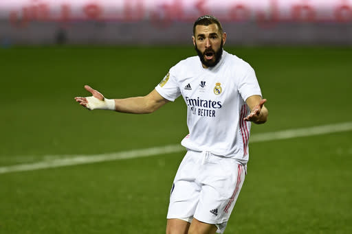 Real Madrid's Karim Benzema gestures during Spanish Super Cup semi final soccer match between Real Madrid and Athletic Bilbao at La Rosaleda stadium in Malaga, Spain, Thursday, Jan. 14, 2021. Athletic Bilbao won 2-1 and will play the final. (AP Photo/Jose Breton)