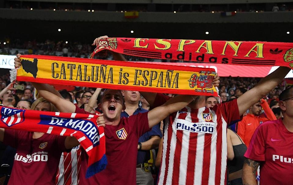 Atletico fans hold up their scarves before their Spanish league match against FC Barcelona at the Wanda Metropolitano stadium in Madrid on October 14, 2017 (AFP Photo/GABRIEL BOUYS )