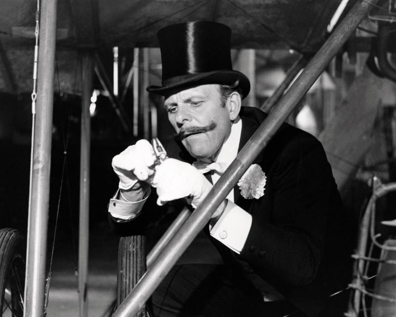 Sir Percy Ware-Armitage, played by English comic actor Terry-Thomas (1911 - 1990), sabotages a rival's aircraft in 'Those Magnificent Men In Their Flying Machines', directed by Ken Annakin, 1965. (Photo by Silver Screen Collection/Getty Images)