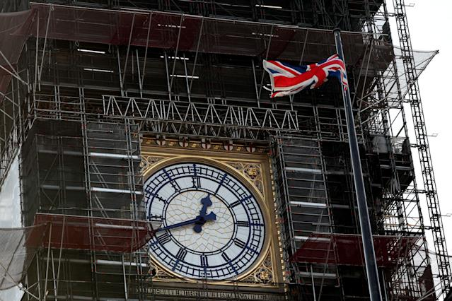 The Union flag flutters near the clock face of Big Ben during ongoing renovations to the Tower and the Houses of Parliament (AFP)