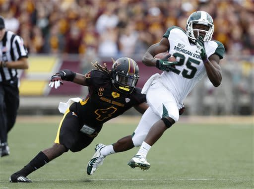 Michigan State receiver Keith Mumphrey (25) runs with the ball as he is pursued by Central Michigan safety Jahleel Addae (4) during the first quarter of an NCAA college football game on Saturday, Sept. 8, 2012, in Mount Pleasant, Mich. (AP Photo/Al Goldis)