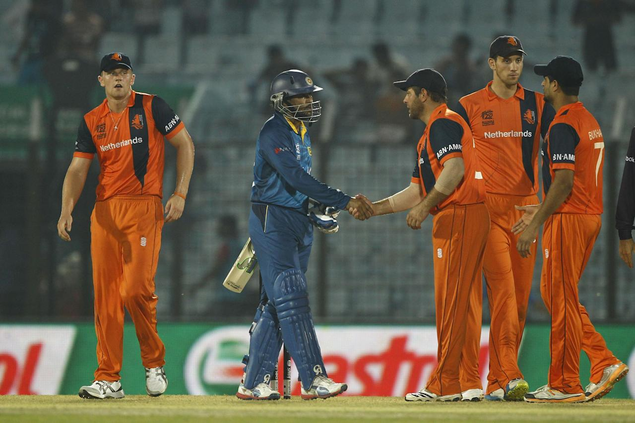 Sri Lanka's Tillakaratne Dilshan, second left, shakes hand with Netherlands players after winning their ICC Twenty20 Cricket World Cup match in Chittagong, Bangladesh, Monday, March 24, 2014. Sri Lanka won by nine wickets. (AP Photo/A.M. Ahad)