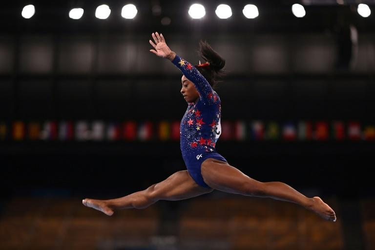 Biles soars and stumbles on the beam