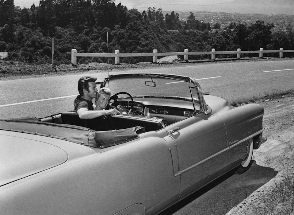 <p>Clint Eastwood sits in a Cadillac with his wife, Maggie Johnson, circa 1960. </p>