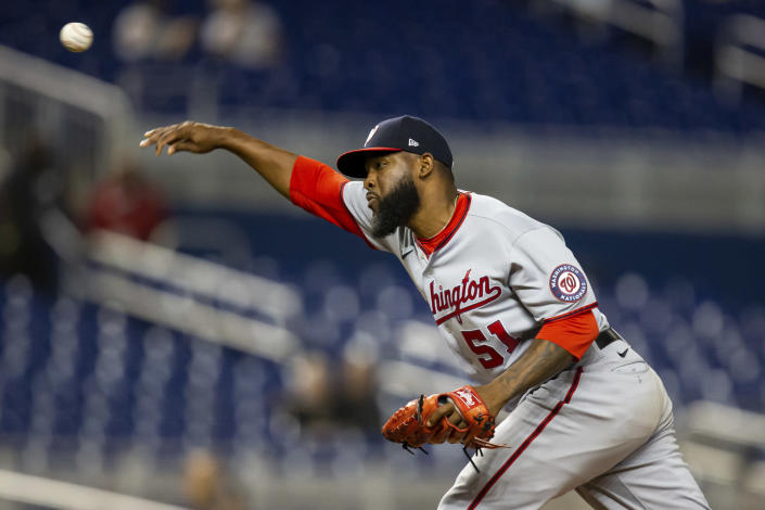 Washington Nationals relief pitcher Wander Suero (51) delivers a pitch during the ninth inning of a baseball game against the Miami Marlins on Thursday, June 24, 2021, in Miami. (AP Photo/Mary Holt)