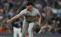 San Francisco Giants starting pitcher Anthony DeSclafani works against the Colorado Rockies in the first inning of a baseball game Saturday, Sept. 25, 2021, in Denver. (AP Photo/David Zalubowski)