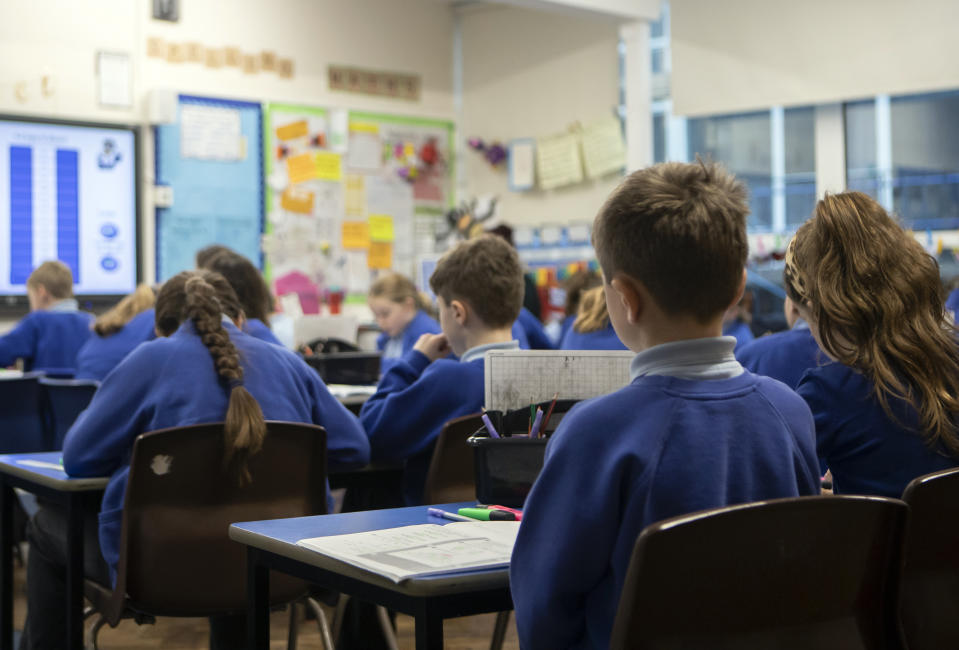 "File photo dated 27/11/19 of school children during a Year 5 class at a primary school. Schools may feel like a ""strange place"" to pupils when they return next month due to safety measures amid the coronavirus pandemic, a leading psychiatrist has warned."