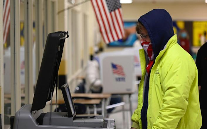 A voter casts his ballot at a polling station on US Election Day in Winchester, Virginia - AFP