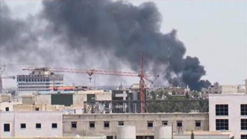 In this image taken from AP video, thick black smoke rises over the Damascus skyline after a powerful explosion rocked the Syrian capital Thursday, June 28, 2012 near a busy market and the country's highest court. (AP Photo/AP video)