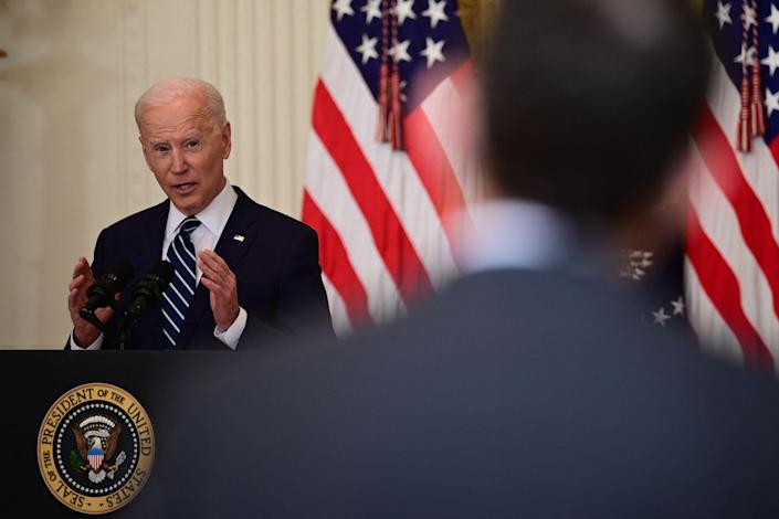 President Joe Biden answers a question during his first press briefing as president in the East Room of the White House.