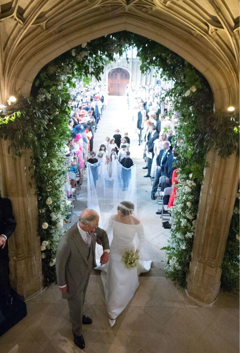 """<p>After her dad <a href=""""https://www.goodhousekeeping.com/life/a19991628/meghan-markle-dad-thomas/"""" rel=""""nofollow noopener"""" target=""""_blank"""" data-ylk=""""slk:Thomas Markle"""" class=""""link rapid-noclick-resp"""">Thomas Markle</a> announced he could no longer attend the wedding due to his health, the future King of England stepped up to the plate. Meghan walked through the first section of the church—the nave—by herself, then the Prince of Wales escorted her up to the altar.</p>"""