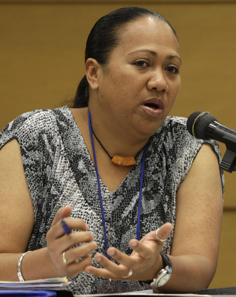 Palau fisheries official Nanette Malsol gestures as she answers questions from reporters before the opening of the 9th regular session of the Western and Central Pacific Fisheries Commission in suburban Manila, Philippines on Sunday Dec. 2, 2012. Several governments and environmentalists have raised an alarm over destructive fishing methods and overfishing that were threatening the Pacific Ocean's bigeye tuna, the fish popular among sushi lovers the world over. (AP Photo/Aaron Favila)