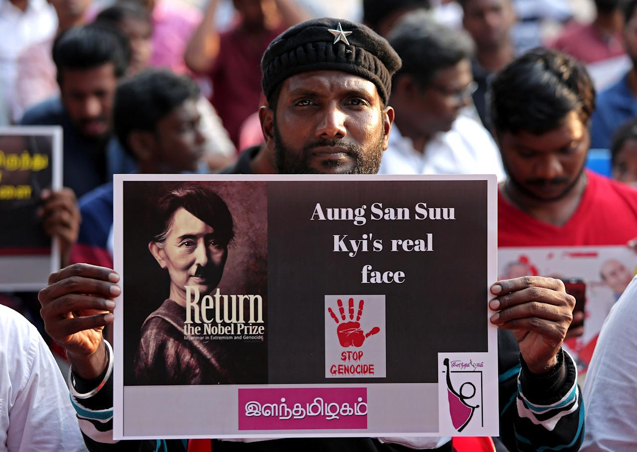 People hold placards during a protest against what they say is Myanmar's persecution of Rohingya Muslims, in Chennai, India September 23, 2017. REUTERS/P.Ravikumar