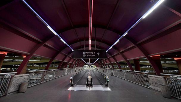 PHOTO: An empty walkway connecting McCarran International Airport to a parking garage is shown amid the spread of the coronavirus on May 14, 2020 in Las Vegas. (Ethan Miller/Getty Images)