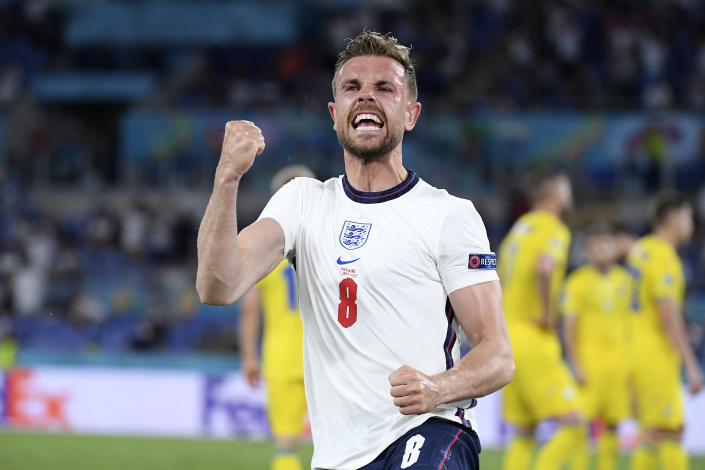 England's Jordan Henderson celebrates after scoring his side's fourth goal during the Euro 2020 soccer championship quarterfinal match between Ukraine and England at the Olympic stadium in Rome, Saturday, July 3, 2021. (AP Photo/Ettore Ferrari, Pool)