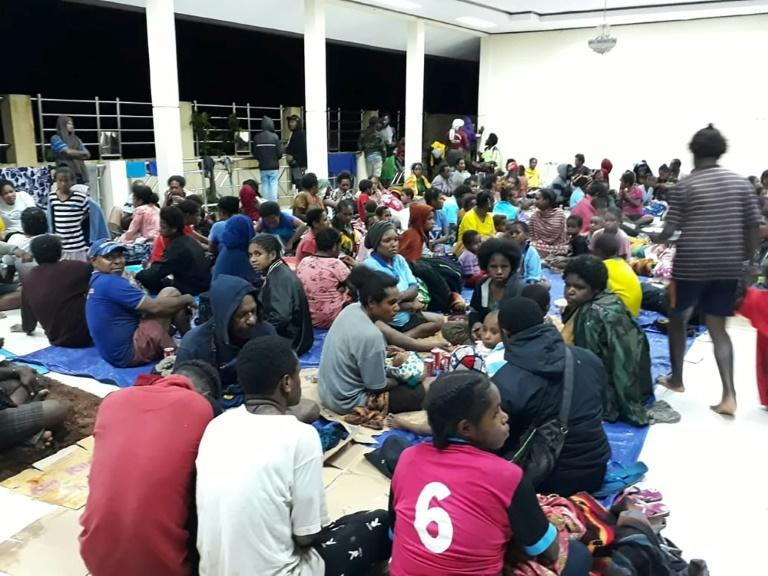 Displaced residents gather at a temporary shelter in Sentani, near the Papuan provincial capital of Jayapura, as floodwaters triggered by torrential rain swamped the area