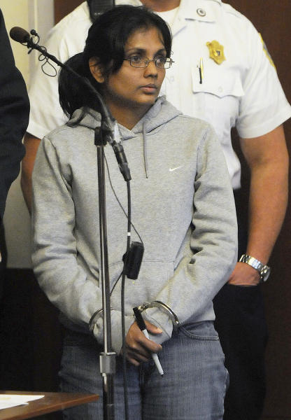 Annie Dookhan, 34, of Franklin, Mass., stands during her arraignment Friday, Sept. 28, 2012, in Boston Municipal Court on two counts of obstruction of justice and pretending to hold a degree for a college or university. Dookhan's alleged mishandling of drug samples prompted the shutdown of a state drug lab in Boston in August and resulted in the resignation of three officials, including the state's public health commissioner. (AP Photo/Boston Herald, Patrick Whittemore, Pool)
