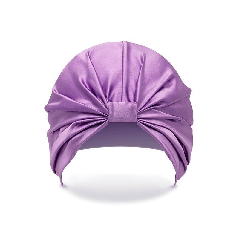 """Gifting a silk turban has double appeal: It protects hair in between <a href=""""https://www.glamour.com/story/erin-parker-wash-day-diaries?mbid=synd_yahoo_rss"""" rel=""""nofollow noopener"""" target=""""_blank"""" data-ylk=""""slk:wash days"""" class=""""link rapid-noclick-resp"""">wash days</a>, and it adds an easy elegance to a work-from-home look. $65, Silke. <a href=""""https://shop-links.co/1721989412261720622"""" rel=""""nofollow noopener"""" target=""""_blank"""" data-ylk=""""slk:Get it now!"""" class=""""link rapid-noclick-resp"""">Get it now!</a>"""