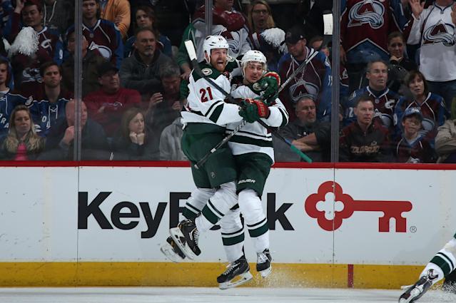 DENVER, CO - APRIL 30: Nino Niederreiter #22 of the Minnesota Wild celebrates his game winning goal with Kyle Brodziak #21 of the Minnesota Wild in overtime against the Colorado Avalanche in Game Seven of the First Round of the 2014 NHL Stanley Cup Playoffs at Pepsi Center on April 30, 2014 in Denver, Colorado. The Wild defeated the Avalanche 5-4 in overtime to win the series. (Photo by Doug Pensinger/Getty Images)