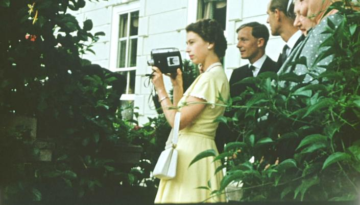 From Factual Fiction  THE QUEEN UNSEEN Thursday 8th April 2021 on ITV   Pictured: A young Queen films with a Cine camera  at a private house, as a guest of the Governor General of New Zealand, Sir Willoughby Norrie (not shown) on Christmas Day, 1953  What: In the middle of a gruelling 6 month tour, The Queen and Prince Philip spent Christmas as guests of the Governor General of New Zealand and his family. The Queen spent much of the visit filming with her beloved 16mm cine camera, enjoying being behind the lens for a change.  The Queen is the most famous woman in the world, yet as she reaches her 95th birthday she remains an enigma. In this unique film, we lift the mask of royalty to reveal the remarkable woman behind the throne. To learn more about the hidden private Elizabeth Windsor, who has sacrificed so much for crown and duty and discover how she has coped with increasing public demands to reveal every aspect of her private self.   Using unseen home movies, intimate informal archive and recently digitised ÔlostÕ material from some of the 116 countries she has visited, weÕll uncover the real Elizabeth Windsor.  In rare off-duty moments weÕll discover The Queen on holiday, as a mother, wife, cook, animal lover, farmer, and expert horsewoman.  This remarkable footage shows her true passions and some of the unlikely, unknown friendships she has forged away from the public eye.  (c) Factual Fiction.  For further information please contact Peter Gray 07831 460 662 peter.gray@itv.com    This photograph is © Factual Fiction and can only be reproduced for editorial purposes directly in connection with the programme. THE QUEEN UNSEEN or ITV. Once made available by the ITV Picture Desk, this photograph can be reproduced once only up until the Transmission date and no reproduction fee will be charged. Any subsequent usage may incur a fee. This photograph must not be syndicated to any other publication or website, or permanently archived, without the express written permis