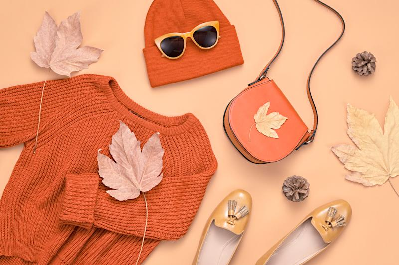 Autumn Arrives. Trendy Knit Jumper, Beanie. Minimal Creative Flat lay. Glamour Shoes, Stylish Sunglasses. Luxury Fall Hipster Girl Outfit, Maple Leaf. Pastel red color.